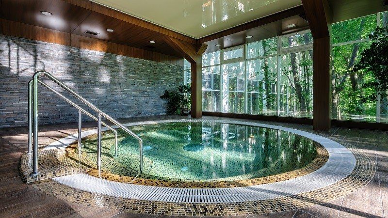 Big luxury jacuzzi thub in hotel spa green area